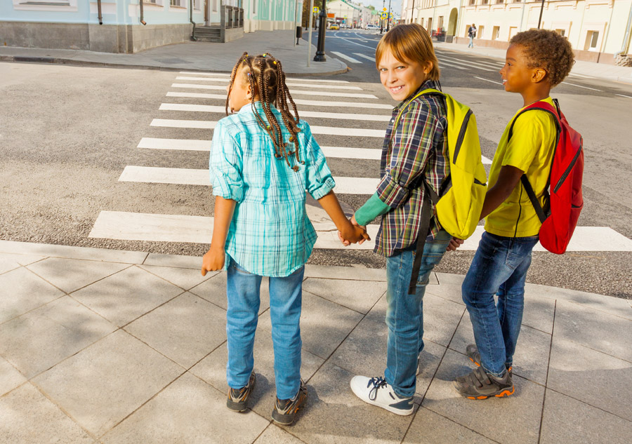 gujral community fund blog image of urban kids crossing at crosswalk